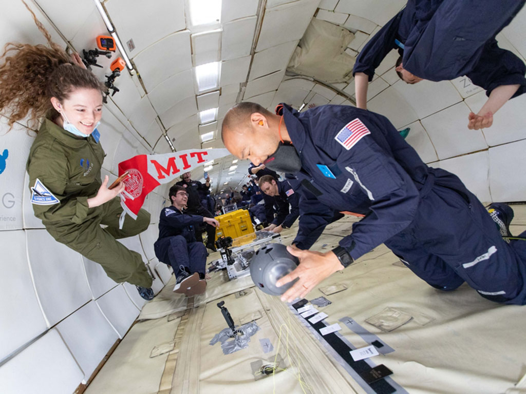 Che-Wei Wang operates the Zenolith, a free-flying pointing device to orient space travelers in the universe, while Ariel Ekblaw looks on. Ekblaw is director of the Space Exploration Initiative at MIT and instructor of a class on preparing research project