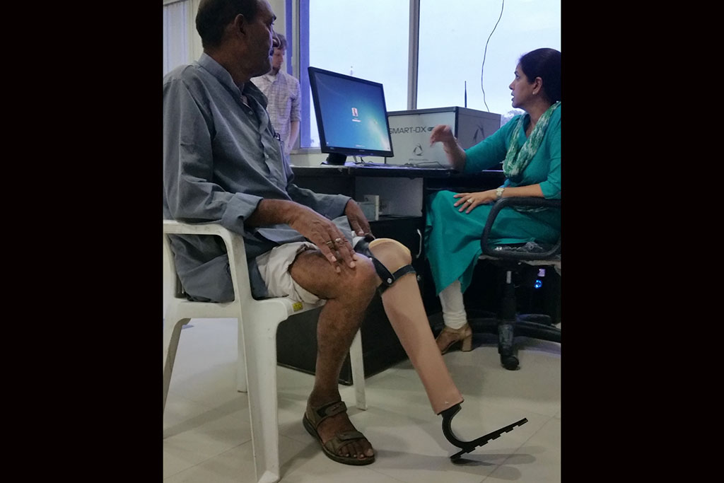 Indian gentleman getting a prosthetic