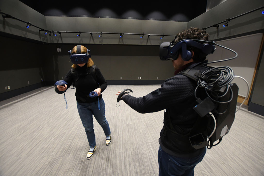 two MIT researches with VR headsets on