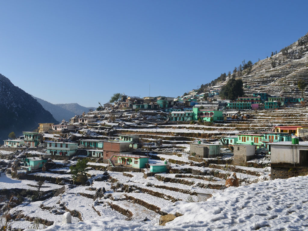 Distance shot of the town of Ransi, India, which is nestled in the Himalaya.