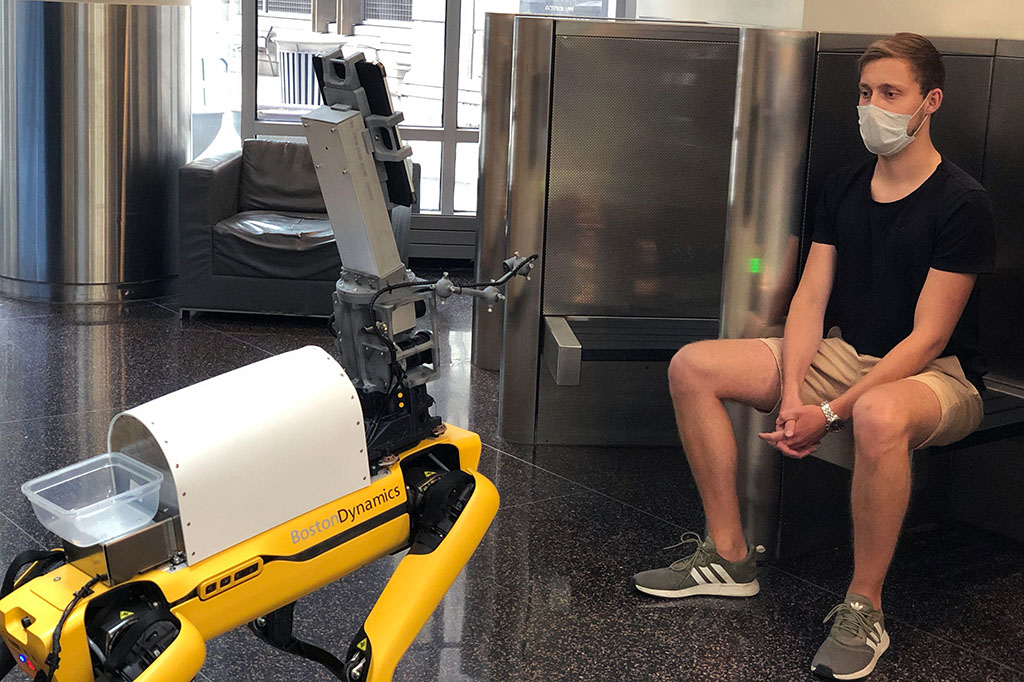 Boston Dynamics Robot taking patient's vitals for COVID safety