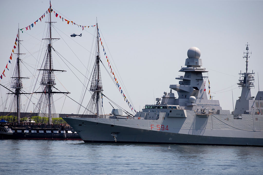 The Italian naval warship ITS Alpino (foreground) sails alongside the USS Constitution in Boston