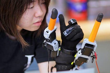 Student Faye Wu is designing a robotic finger system you can control with your mind.