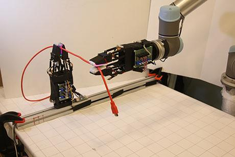 Letting robots manipulate cables