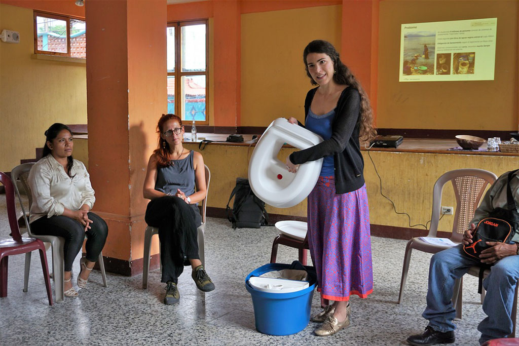 Mona Mijthab, the founder of 2.729 client MoSan, demonstrates MoSan's ecological sanitation  system