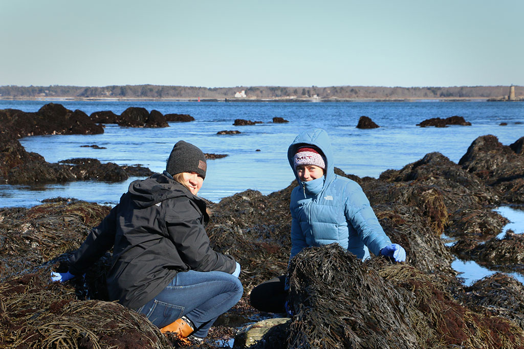 two students on rocks