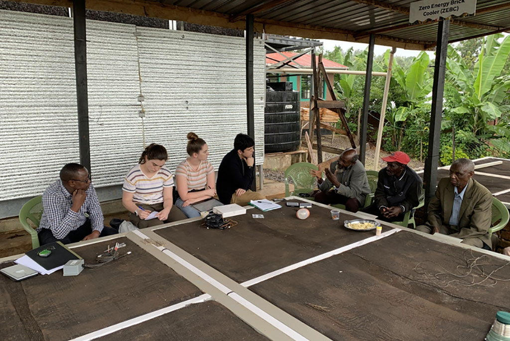 MIT students discussing evaporative cooling chambers with farming cooperatives members in Karurumo, Kenya.