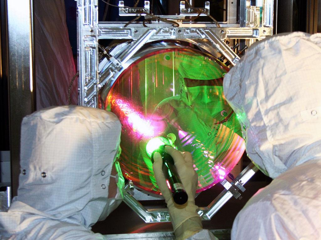 MIT scientists have cooled a 10-kilogram object to a near standstill, using LIGO's precise measurements of its 40-kilogram mirrors. Shown here are LIGO optics technicians examining one of LIGO's mirrors.
