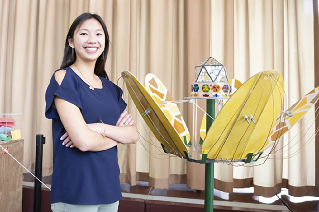Stephanie Chou '19 stands with her kinetic art sculpture