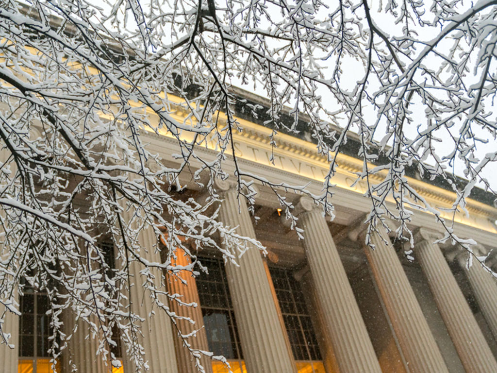 View of MIT Building 10 from Killian Court during snowy weather