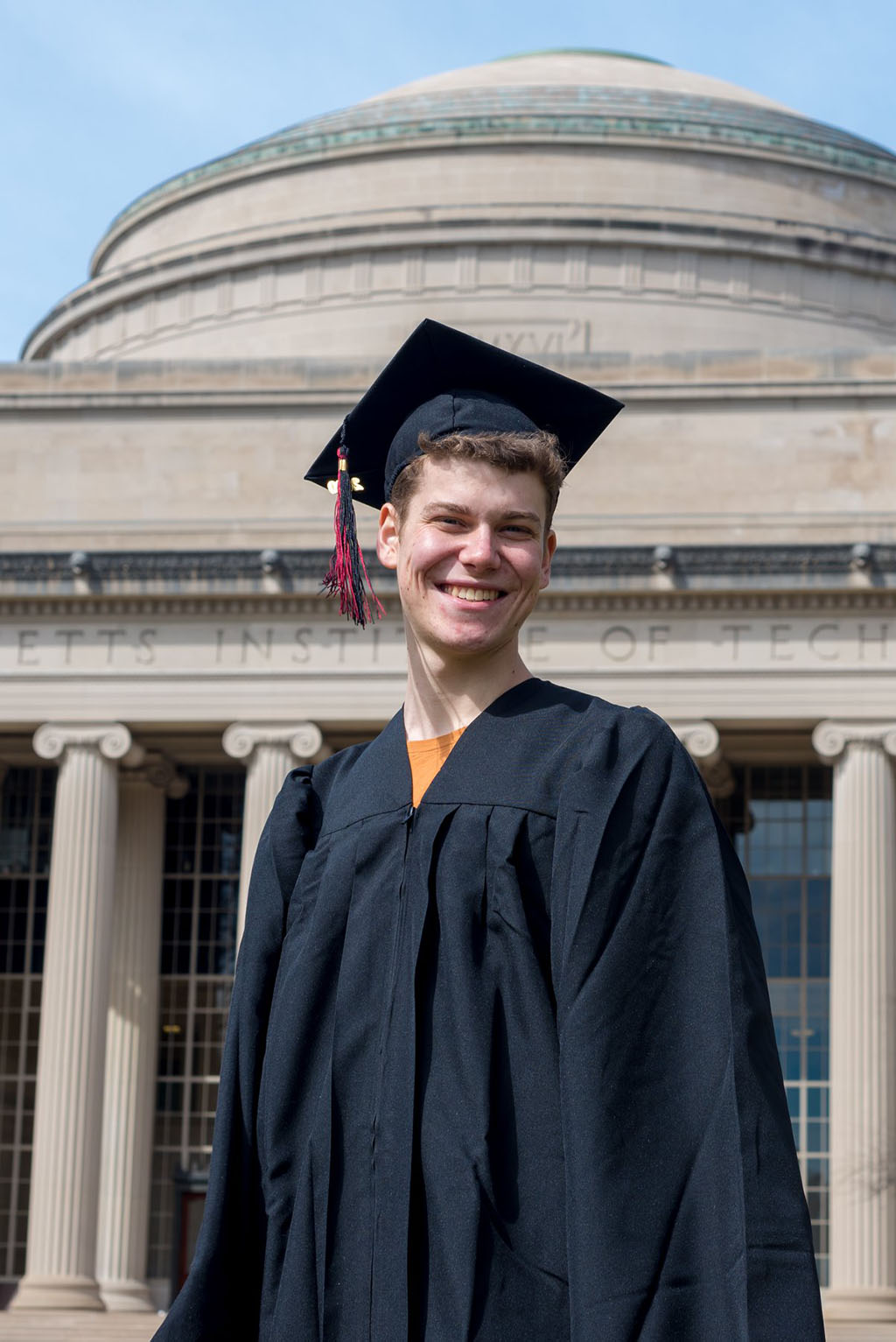 Portrait of Max Kessler in front of MIT dome