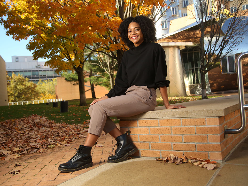 Portrait of mechanical engineering senior Orisa Coombs outside the Stata Center at MIT.