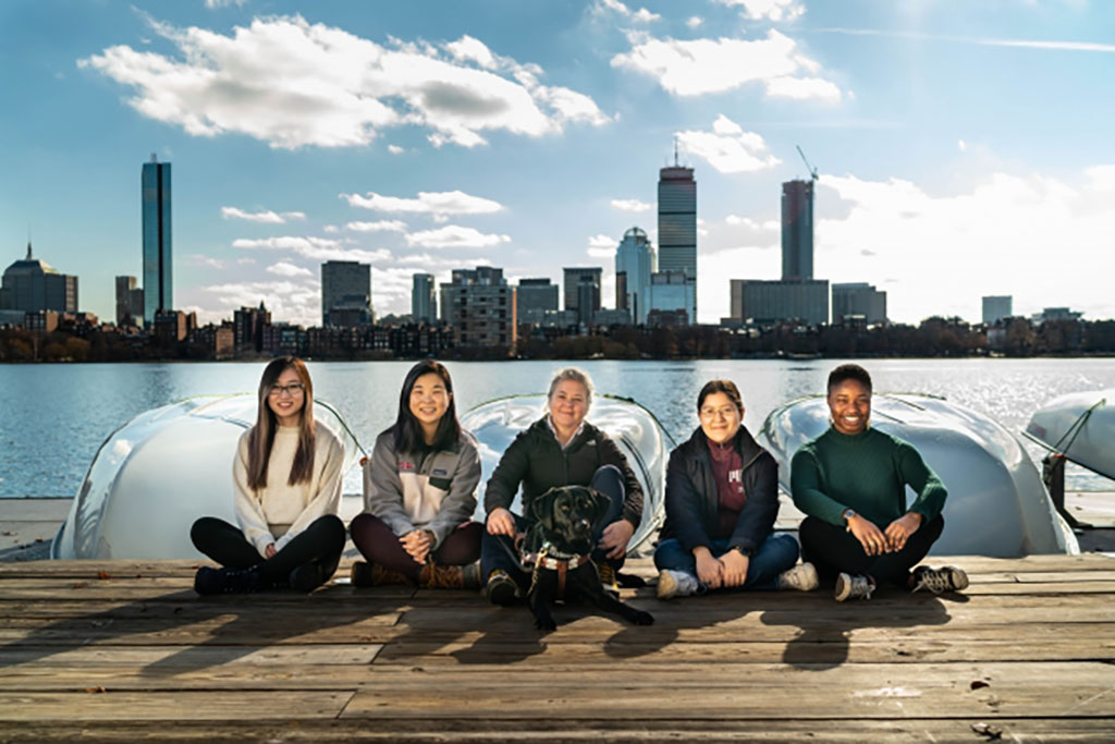the group od students sitting on a dock
