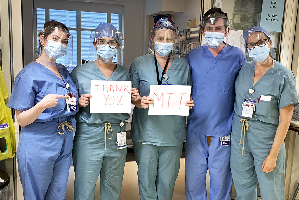 "Medical worker holding an ""MIT Thank You"" sign"